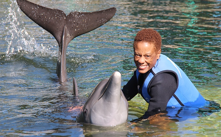 Woman holding a dolphin