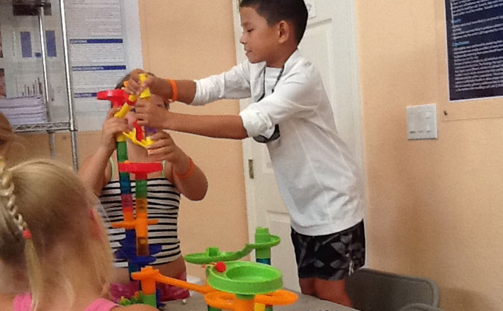 Dolphins Plus summer camp kids build