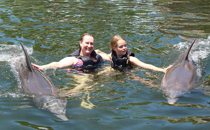 Oma's dolphin swim program for cancer fighters