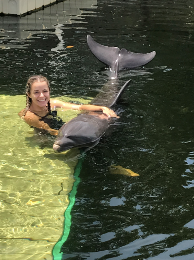Molly Swimming with Dolphin